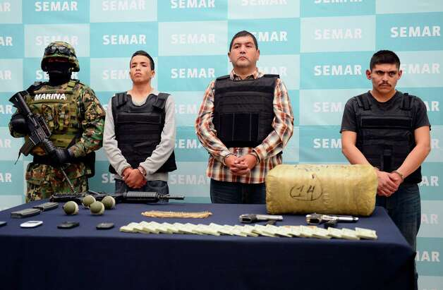 "Authorities show off Ivan Velázquez ""El Taliban"" Caballero (second from the right), at Thursday's press conference at naval headquarters in Mexico City. Photo: ALFREDO ESTRELLA, AFP/Getty Images / AFP"