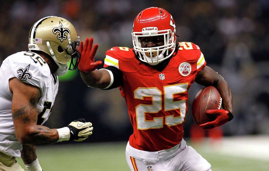 Kansas City Chiefs running back Jamaal Charles (25) carries as New Orleans Saints linebacker Jonathan Casillas (52) pursues in the first half of an NFL football game at the Mercedes-Benz  Superdome in New Orleans, Sunday, Sept. 23, 2012. (AP Photo/Gerald Herbert) Photo: Gerald Herbert, STF