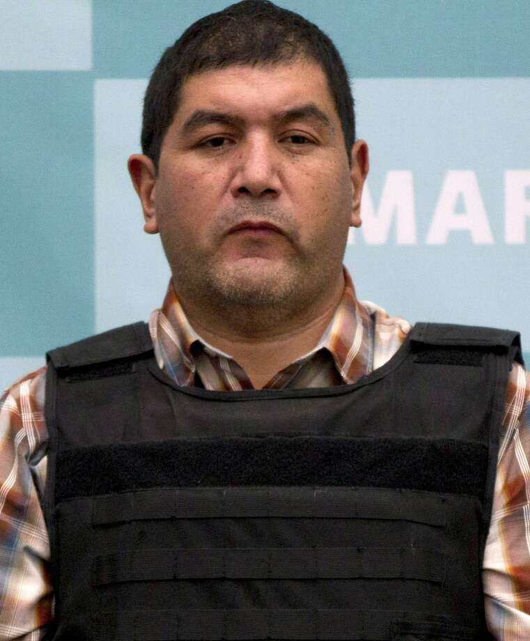 "The alleged leader of a faction of the hyper-violent Zetas cartel, Ivan Velazquez Caballero, known as ""El Taliban,""  is shown during a media presentation at the Mexican Navy's Center for Advanced Naval Studies in Mexico City,Thursday, Sept. 27, 2012. Velazquez Caballero allegedly has been fighting a bloody internal battle with top Zetas' leader Miguel Angel Trevino Morales, and officials have said the split was behind a recent surge in massacres and shootouts, particularly in northern Mexico. (AP Photo/Eduardo Verdugo) Photo: Eduardo Verdugo, Associated Press"