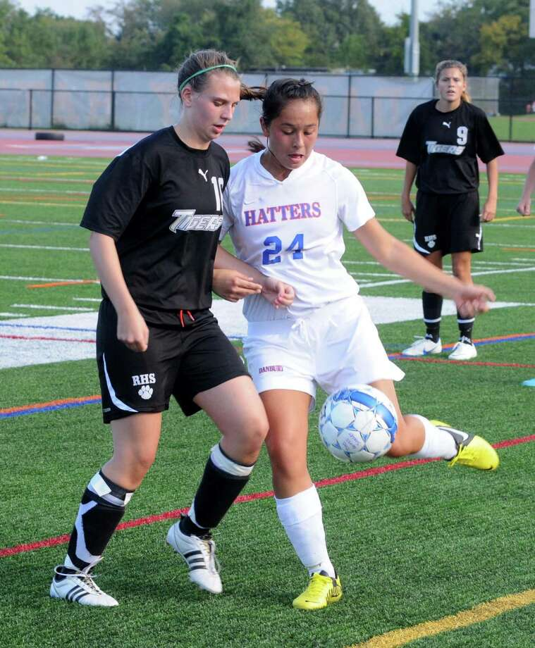 Soccer action between Ridgefield High Schools Kelsey Hauser and Danbury High Schools Carina Zamudio during their game at Danbury on Thursday, September 27, 2012. Photo: Lisa Weir / The News-Times Freelance