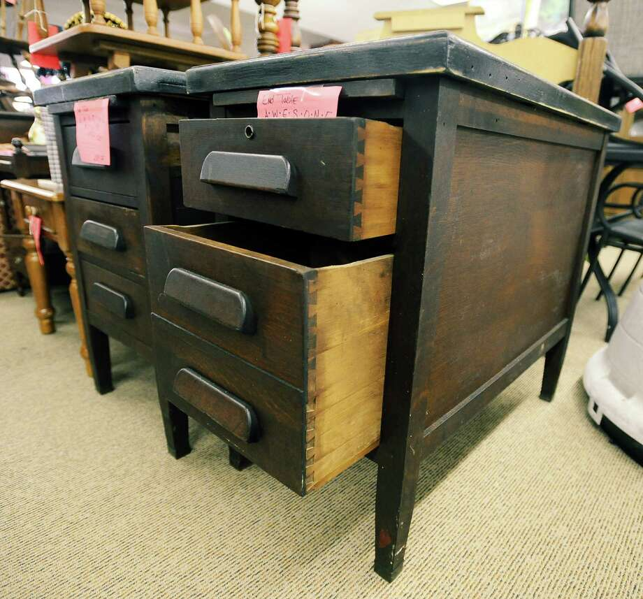 The Treasure House of St Mark's in Beaumont once had a heavy duty office desk that was not going to sell.  By cutting the sides off, adding a little paint, and giving it new life they offer end tables that are perfect for any home.  Photo taken: Randy Edwards/The Enterprise