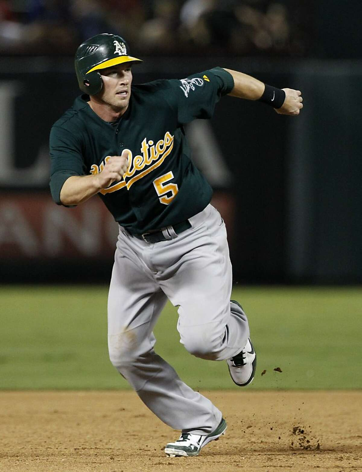 Oakland Athletics' Stephen Drew (5) advances to third on a ground out by Yoenis Cespedes in the eighth inning of a baseball game against the Texas Rangers, Wednesday, Sept. 26, 2012, in Arlington, Texas. Drew had four of Oakland's 16 hits, including a double leading off the game in the 9-3. Athletics win. (AP Photo/Tony Gutierrez)