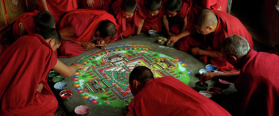 "Monks create a sand mandala in one of several spiritual activities depicted in ""Samsara."" / ONLINE_YES"