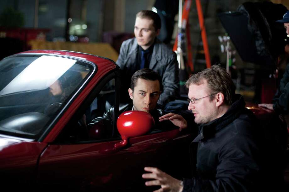 """Joseph Gordon-Levitt as """"Joe"""", Paul Dano as """"Seth"""" and writer/ director Rian Johnson in TriStar Pictures, Film District, and End Game Entertainment's action thriller """"Looper."""" (Courtesy of Alan Markfield/MCT) Photo: Handout / MCT"""