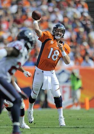Even with his troubles, Peyton Manning has been more effective throwing deep than Carson Palmer. Photo: Jack Dempsey, Associated Press