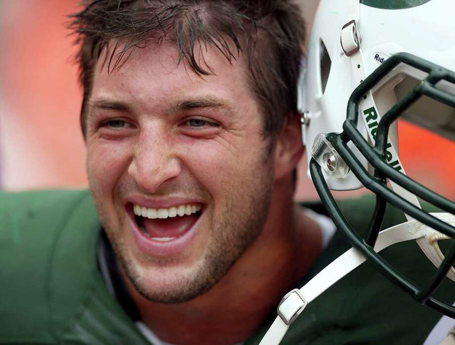 New York Jets quarterback Tim Tebow is a polarizing figure, both for his religious views and his talent. Photo: Marc Serota / 2012 Getty Images