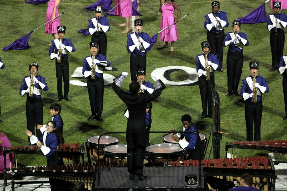 "The Morton Ranch High School marching band performs ""By the Light of the Moon"" at halftime at Rhodes Stadium in Katy. There are 238 students in the band program. Photo: Billy Smith II / © 2012 Houston Chronicle"