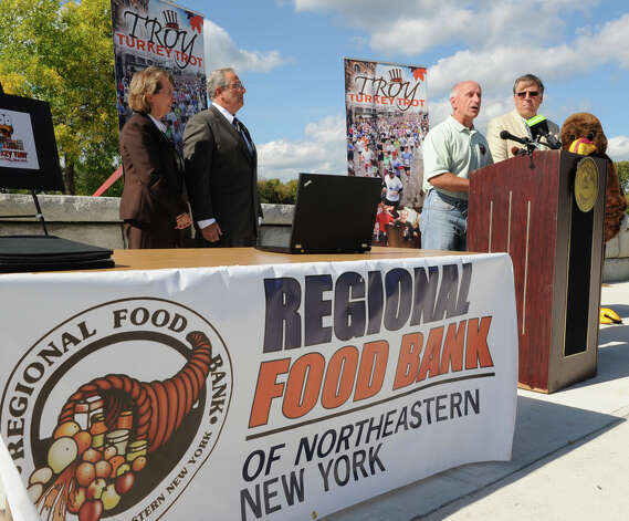 Mark Quandt, executive director of the Regional Food Bank, speaks during a press conference announcing details of the 65th Annual Troy Turkey Trot on Thursday, Sept. 27, 2012 in Troy, N.Y. Also attending the press conference from left, Rensselaer County Executive Kathy Jimino, Troy Mayor Lou Rosamilia and George Regan of USA Track and Field Adirondack. (Lori Van Buren / Times Union) Photo: Lori Van Buren