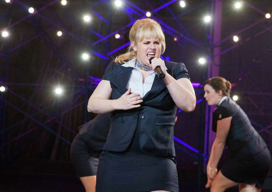 """Fat Amy (Rebel Wilson) belts out a tune with the Bellas in """"Pitch Perfect."""" Photo: Peter Iovino / Universal Pictures"""