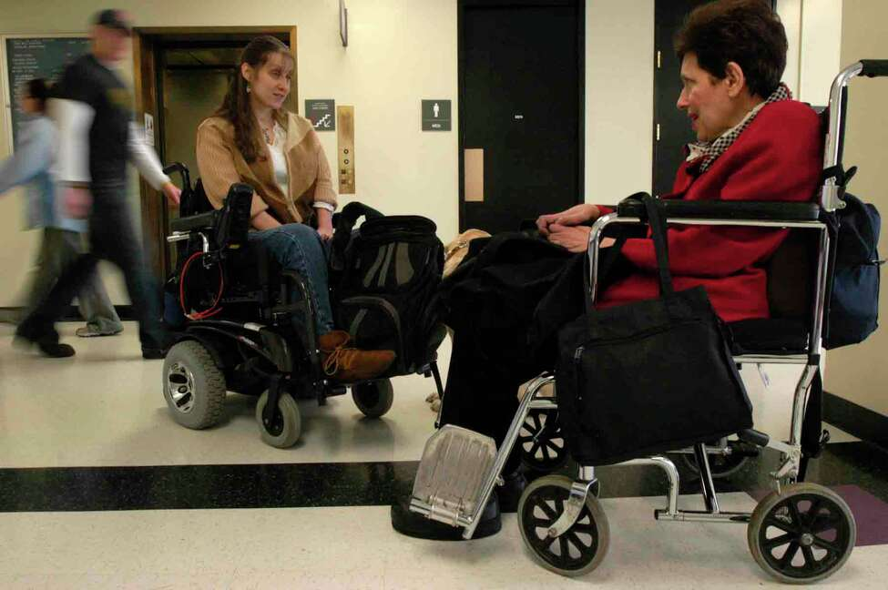 Constance Laymon, left, talks with University at Albany professor Sarah Blacher Cohen in a 2005 photos at Cohen's The Drama of Disability class. (Paul Buckowski/Times Union archive)