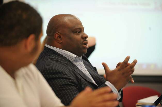 Bridgeport Board of Education member Kenneth Moales Jr. talks with other board members Thursday, Sept. 27, 2012 during a day long retreat for the board hosted by Sacred Heart University off campus at their Cambridge Building in Trumbull. Photo: Autumn Driscoll / Connecticut Post