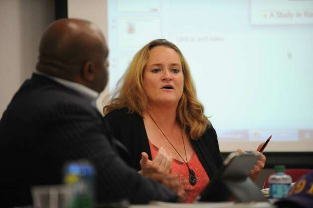 Jacqueline Kelleher, Bridgeport Board of Education President, talks with other board members Thursday, Sept. 27, 2012 during a day long retreat for the board hosted by Sacred Heart University off campus at their Cambridge Building in Trumbull. Photo: Autumn Driscoll / Connecticut Post