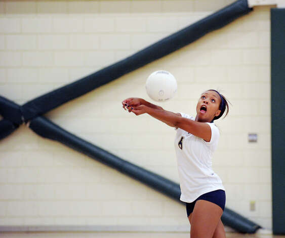 Khandice Dyson # 6 of King returns a shot during the girls high school volleyball match between Greenwich Academy and King at Greenwich, Thursday, Sept. 27, 2012. Photo: Bob Luckey / Greenwich Time