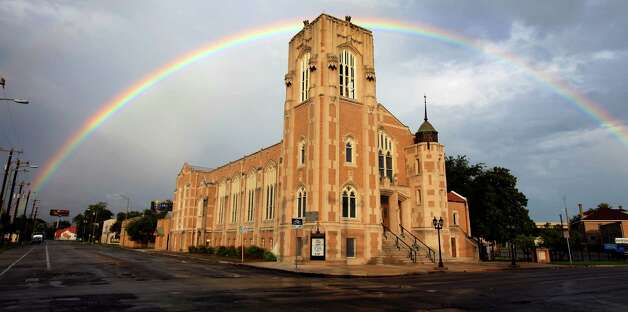 A rainbow is seen Thursday afternoon, Sept. 26, 2012, over Grace Lutheran Church downtown. Forecasters are calling for possibly heavy rain Friday night and Saturday. Photo: William Luther, San Antonio Express-News / © 2012 William Luther