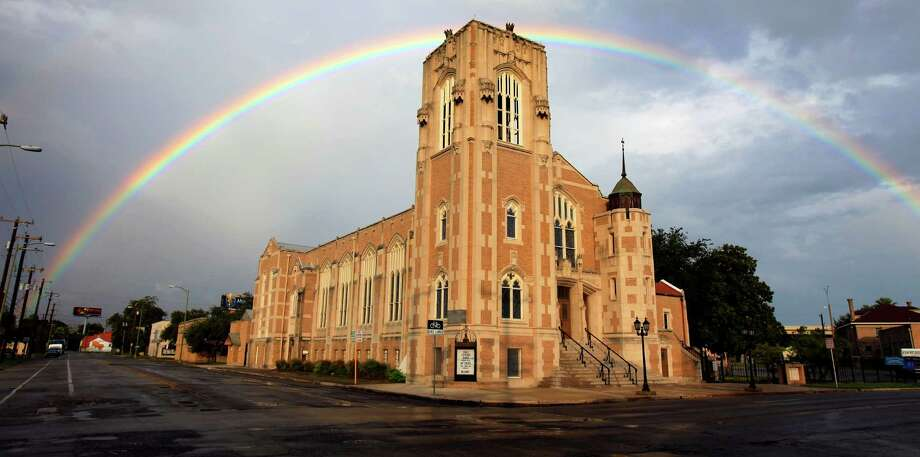 A rainbow is seen Thursday afternoon Sept. 26, 2012 over Grace Lutheran Church downtown. Forecasters are calling for possibly heavy rain Friday night and Saturday. Photo: William Luther, San Antonio Express-News / © 2012 William Luther