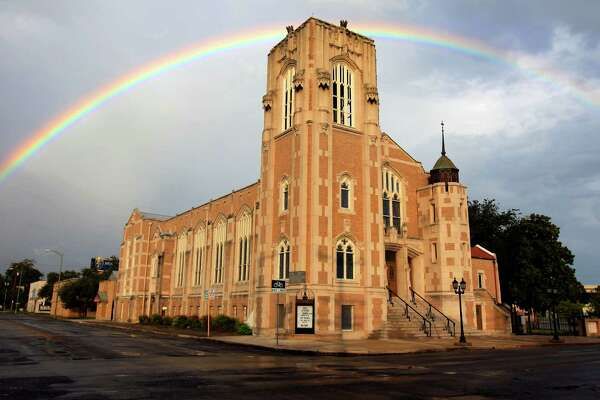 A rainbow is seen Thursday afternoon Sept. 26, 2012 over Grace Lutheran Church downtown. Forecasters are calling for possibly heavy rain Friday night and Saturday.