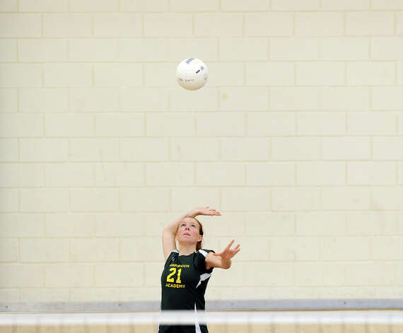 Zoe Morris # 21 of Greenwich Academy serves during the girls high school volleyball match between Greenwich Academy and King at Greenwich, Thursday, Sept. 27, 2012. Photo: Bob Luckey / Greenwich Time