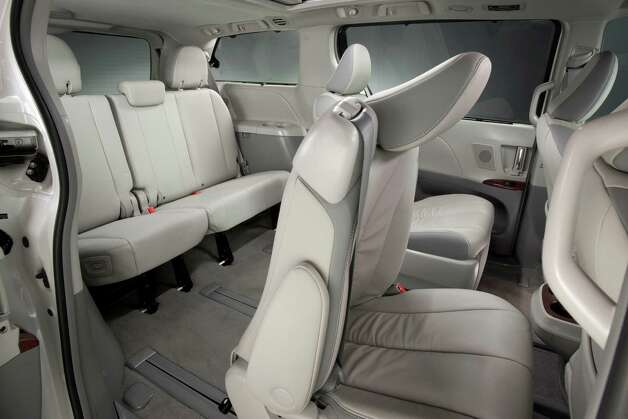 Availalble middle-row captain's chairs in the 2012 Sienna minivan can slide fore and aft up to 23 inches to increase legroom or allow for easier access in the third row. Photo: Toyota Motor Sales U.S.A.