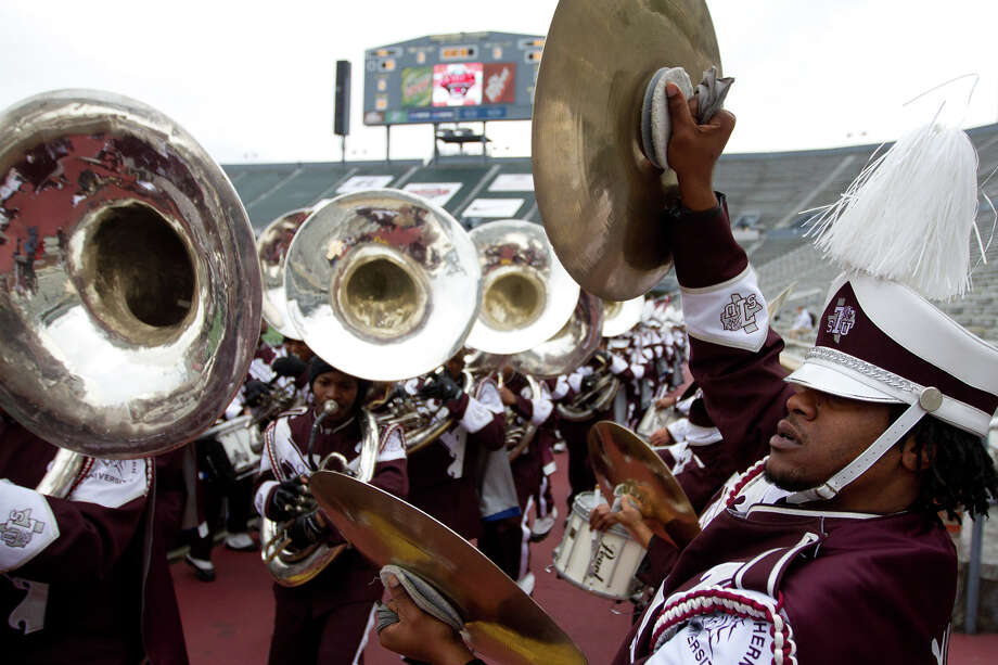 Greg Hayes, right, plays with the Ocean of Soul band as they march into the stadium before the Texas Southern Tigers face the Alabama State Hornets in the 2010 Farmers Insurance SWAC Football Championship Game at Legion Field  on Saturday, Dec. 11, 2010, in Birmingham, Ala.( Smiley N. Pool / Houston Chronicle ) Photo: Smiley N. Pool / Houston Chronicle