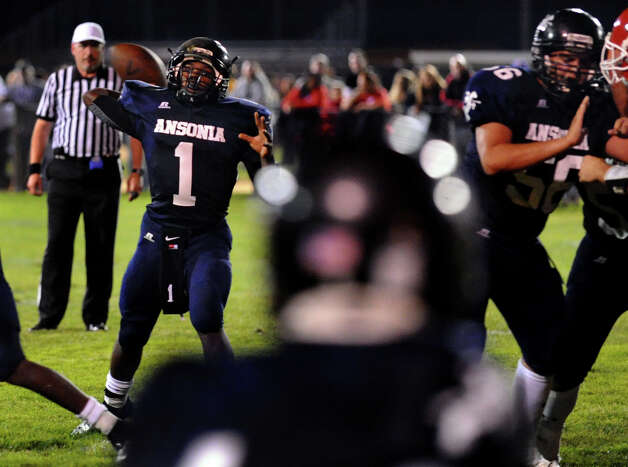 Ansonia QB Jaiquan McKnight prepares to release a pass, during football action against Derby in Ansonia, Conn. on Thursday September 27, 2012. Photo: Christian Abraham / Connecticut Post