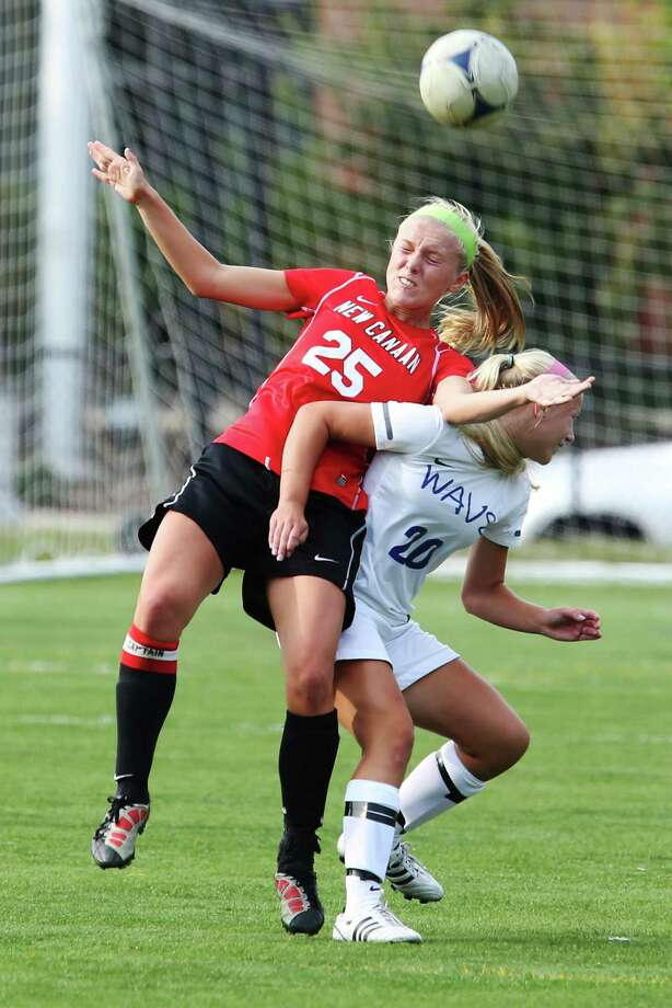 Mike Ross Connecticut Post freelance - New Canaan's # 25 Kelly Armstrong and Darien's #20 Kelly Karczewski battle for the ball during Thursday afternoon match-up. Photo: Mike Ross / Connecticut Post Freelance