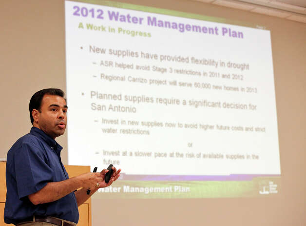 Greg Flores of SAWS speaks about the utility's water plan at a public meeting Thursday. A SAWS survey found 74%  of ratepayers favor water restrictions  over planned rate hikes. Photo: Edward A. Ornelas, San Antonio Express-News / © 2012 San Antonio Express-News
