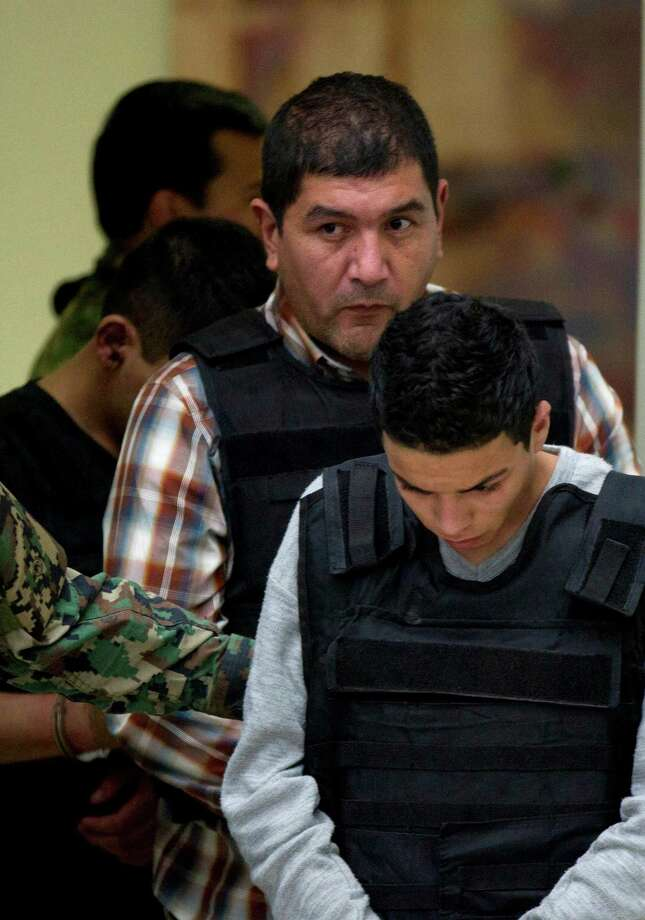 "Ivan Velázquez Caballero, center, known as ""El Taliban,"" only recently split with the Zetas gang. Photo: Eduardo Verdugo / AP"