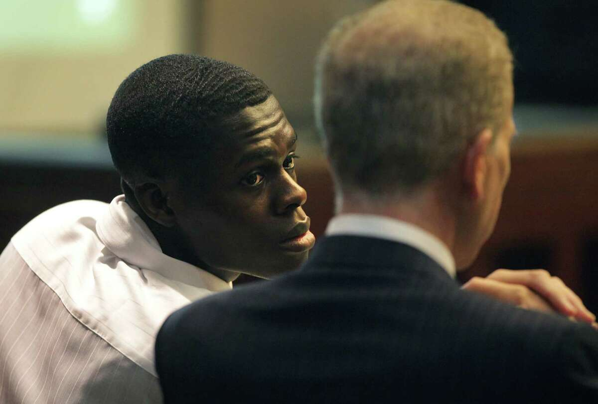 Kwaku Agyin, left, confers with his attorney Mario Trevino during his child sex trafficking trial in Judge Lori Valenzuela's 437th state District Court. Wednesday, Sept. 26, 2012.