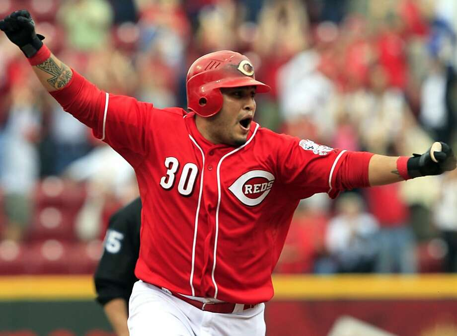 Cincinnati Reds' Dioner Navarro celebrates after hitting a triple to drive in the winning run in the bottom of the ninth inning against the Milwaukee Brewers. Photo: Al Behrman, Associated Press