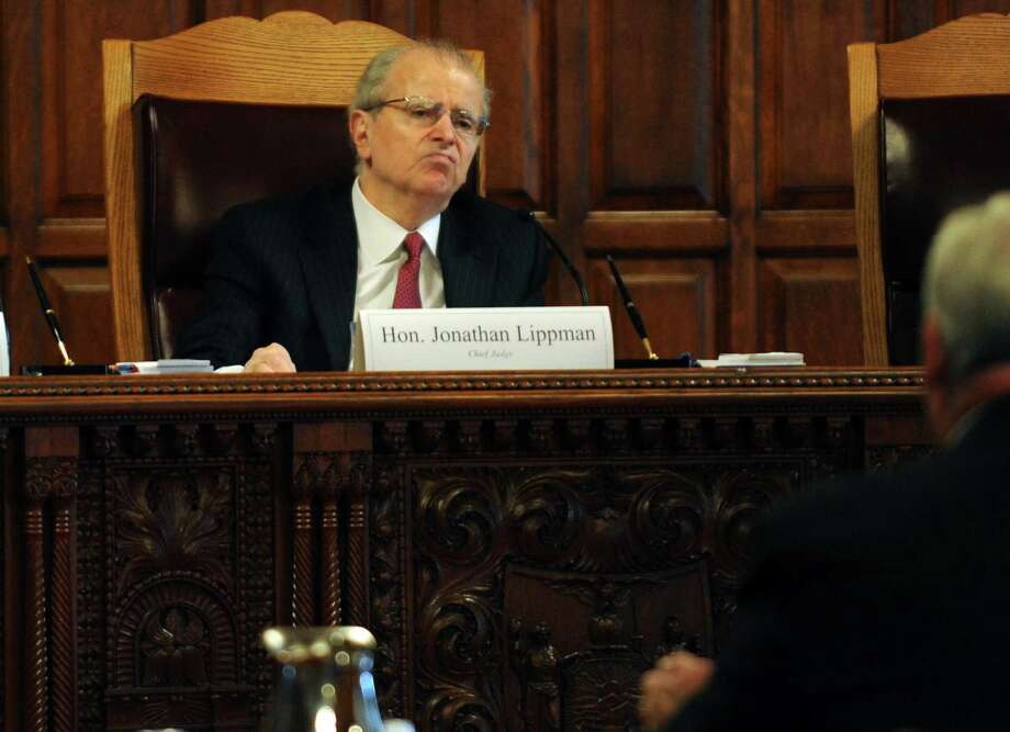 State Court of Appeals Chief Judge Jonathan Lippman,center, conducts a public hearing on civil legal services in Albany , NY Thursday Sept. 27, 2012. (Michael P. Farrell/Times Union) Photo: Michael P. Farrell