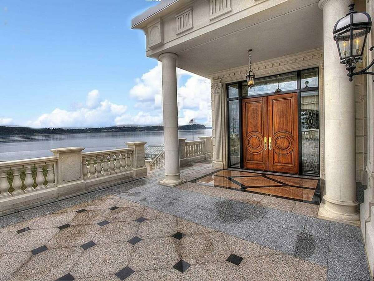 Entry of 9934 Point View St. N.E., on Johnson Point, near Olympia. The 13,335-square-foot house has four bedrooms and 5.5 bathrooms, ornate moldings, vaulted, beamed ceilings, skylights, French doors, a bar, a gym, balconies, views of Puget Sound and the Olympic Mountains, and a cannon on a 1.89-acre lot along the sound. It's listed for $6,088,800.