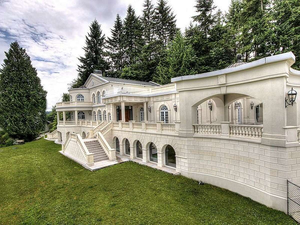 Want to live like a duke? Check out 9934 Point View St. N.E., on Johnson Point, near Olympia. The 13,335-square-foot house has four bedrooms and 5.5 bathrooms -- including a master bathroom with a mural on the ceiling -- ornate moldings, vaulted, beamed ceilings, skylights, French doors, a theater, a bar, a gym, balconies, views of Puget Sound and the Olympic Mountains, and a cannon on a 1.89-acre lot along the sound. It's listed for $6,088,800.