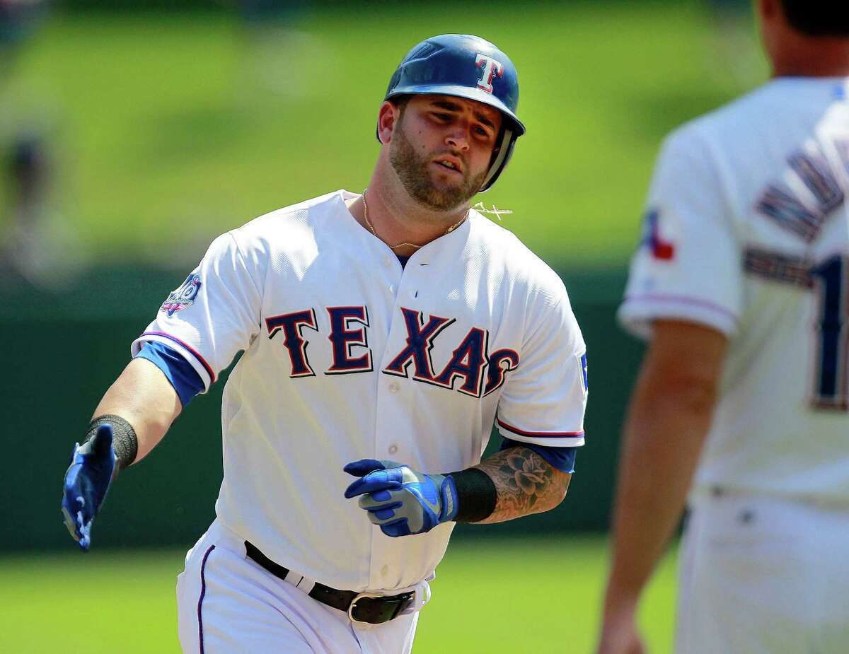 Texas' Mike Napoli rounds third base after a homer in the first.
