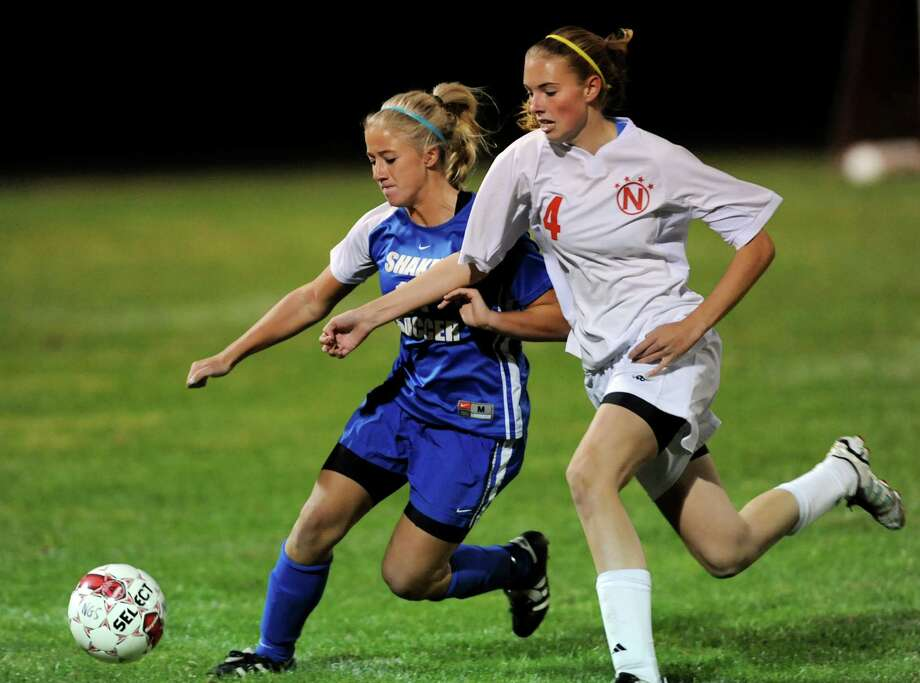 Shaker's Kate Essepian (17), left, and Niskayuna's Meghan Doyle (4) pursue a loose ball during their soccer game on Thursday, Sept. 27, 2012, at Niskayuna High in Niskayuna, N.Y. (Cindy Schultz / Times Union) Photo: Cindy Schultz / 00019409A