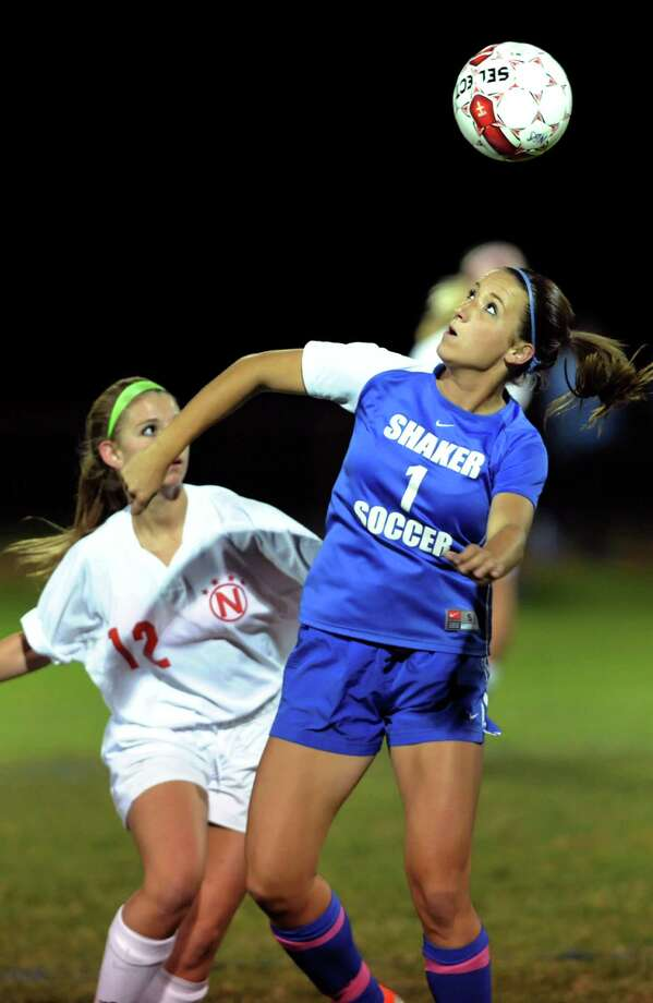 Shaker's Jessica Hogan (1), right, hits the header over Niskayuna's Hailey Golub (12) during their soccer game on Thursday, Sept. 27, 2012, at Niskayuna High in Niskayuna, N.Y. (Cindy Schultz / Times Union) Photo: Cindy Schultz / 00019409A