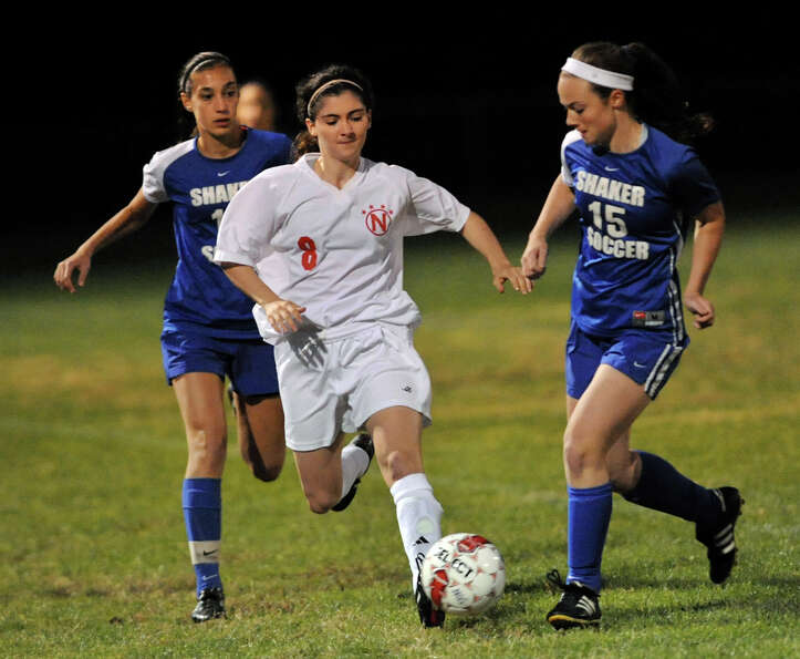 Niskayuna's Jenny Cascino (8), center, controls the ball as Shaker's Jean Mary Chakmakas (10), left,