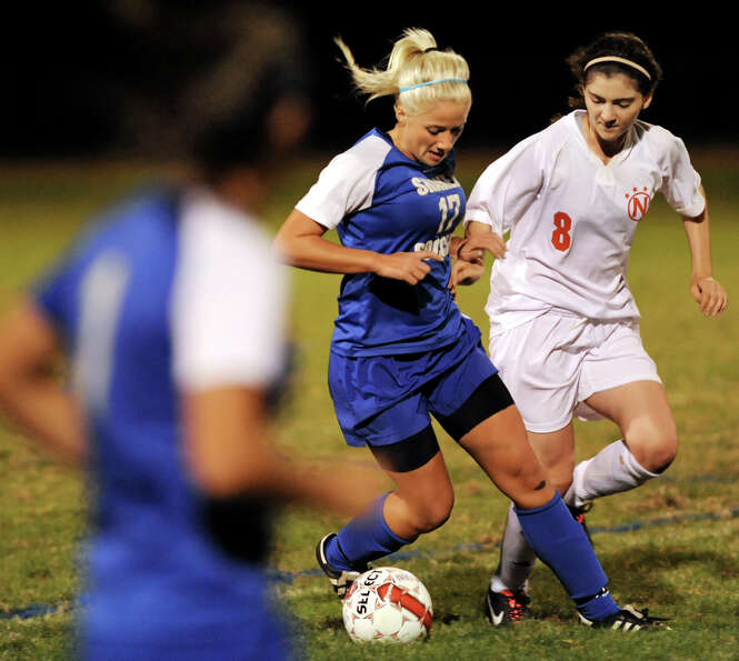 Shaker's Kate Essepian (17), left, controls the ball as Niskayuna's Jenny Cascino (8) defends during
