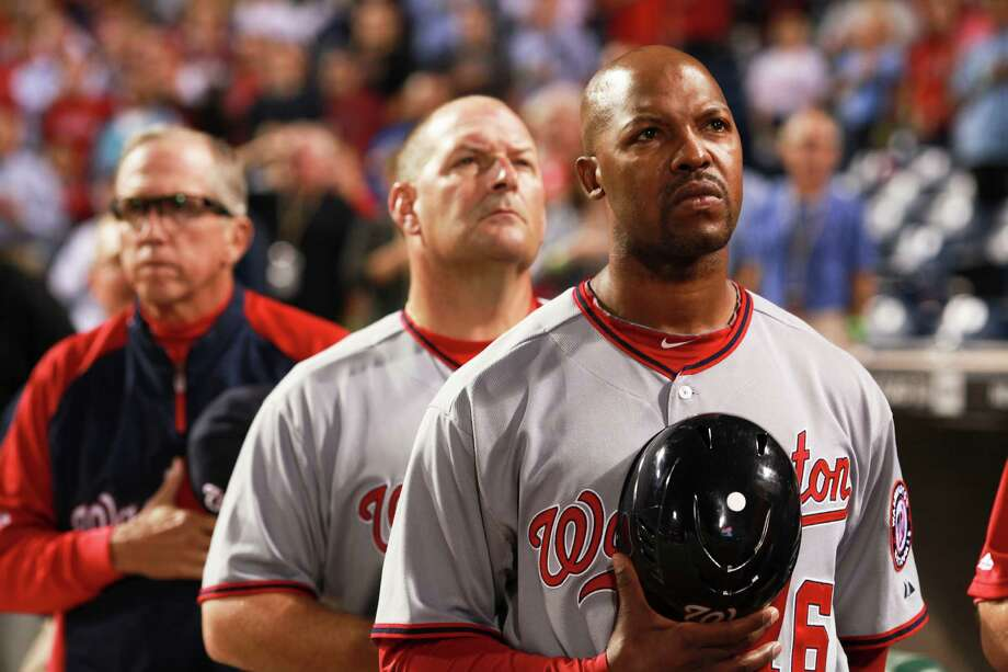 Washington Nationals' third base coach Bo Porter stands for the playing of the National Anthem before their game against the Philadelphia Phillies, Thursday, Sept. 27, 2012 in Philadelphia. Photo: DOUGLAS BOVITT, Douglas Bovitt / © 2012 Houston Chronicle