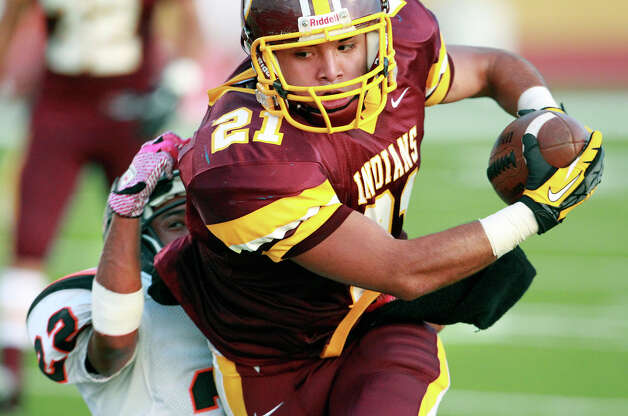 Harlandale running back Nicholas Martinez lunges toward a first quarter touchdown as Harlandale hosts Medina Valley at Harlandale Stadium on September 27, 2012. Photo: Tom Reel, Express-News / ©2012 San Antono Express-News