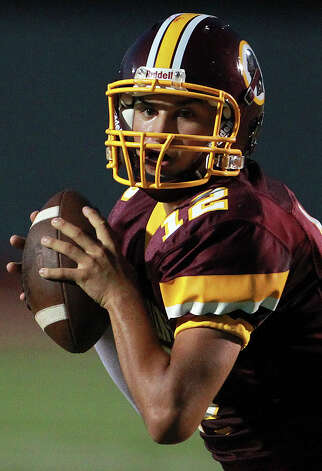 Brandon Ramon spots a receiver for the Indians as Harlandale hosts Medina Valley at Harlandale Stadium on September 27, 2012. Photo: Tom Reel, Express-News / ©2012 San Antono Express-News