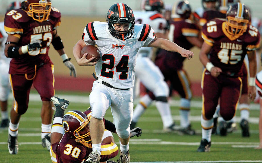 Panther running back Weston Beck gets clear on a long run in the first half as Harlandale hosts Medina Valley at Harlandale Stadium on September 27, 2012. Photo: Tom Reel, Express-News / ©2012 San Antono Express-News