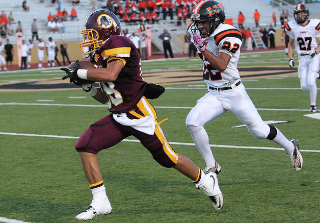 Indian receiver James Mendoza sprints in for a touchdown behind David Torres after grabbing a long bomb from Brandon Ramon as Harlandale hosts Medina Valley at Harlandale Stadium on September 27, 2012. Photo: Tom Reel, Express-News / ©2012 San Antono Express-News