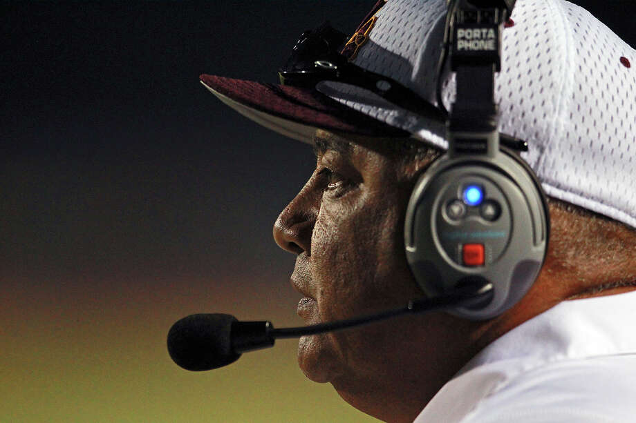 Harlandale head coach Isaac Martinez watches as Harlandale hosts Medina Valley at Harlandale Stadium on September 27, 2012. Photo: Tom Reel, Express-News / ©2012 San Antono Express-News