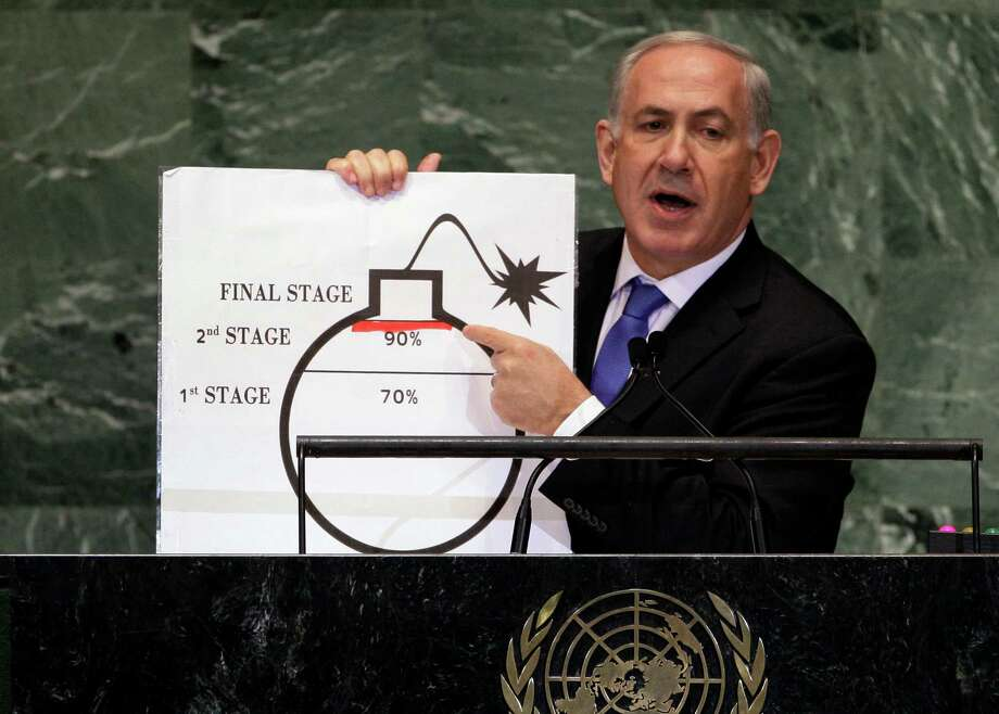 Prime Minister Benjamin Netanyahu of Israel shows an illustration as he describes his concerns over Iran's nuclear ambitions during his address to the 67th session of the United Nations General Assembly at U.N. headquarters Thursday, Sept. 27, 2012.(AP Photo/Richard Drew) Photo: Richard Drew