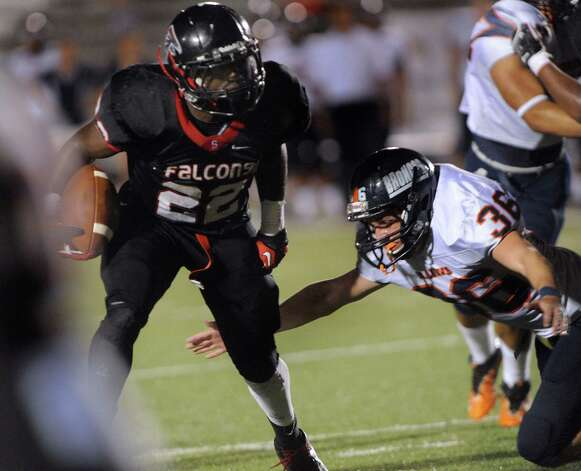 Running back Marquie Hinton of Stevens avoids a tackle attempt by Hayden Kovatch (36) of Brandeis during high-school football action at Gustafson Stadium on Thursday, Sept. 27, 2012. Photo: Billy Calzada, Express-News / © San Antonio Express-News