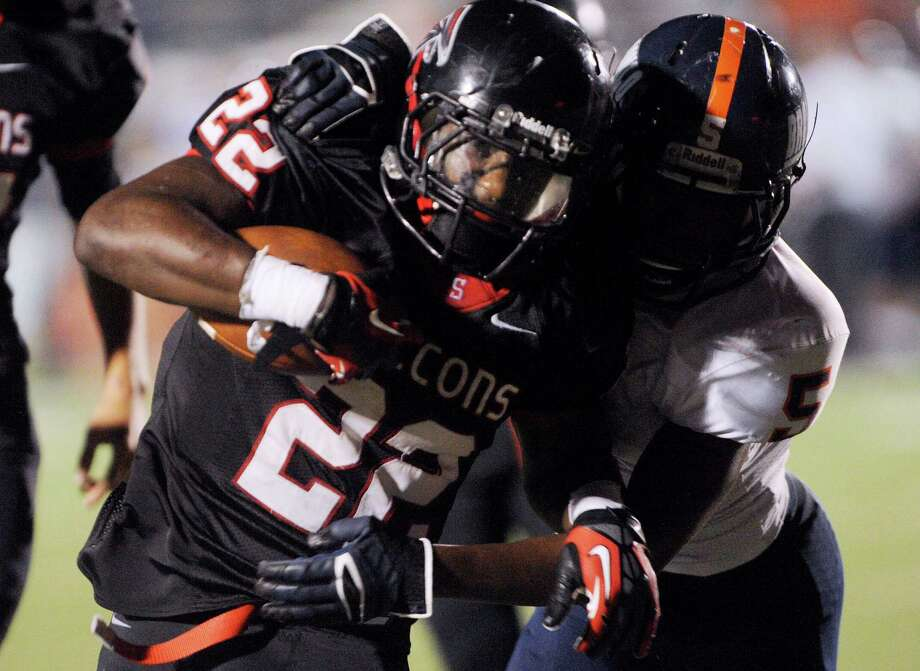 Marquie Hinton (22) of Stevens is wrestled down by Faissal Shabani (5) of Brandeis during high-school football action at Gustafson Stadium on Thursday, Sept. 27, 2012. Photo: Billy Calzada, Express-News / © San Antonio Express-News