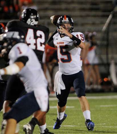 Brandeis quarterback Colbie Price throws against the Stevens defense during high-school football action at Gustafson Stadium on Thursday, Sept. 27, 2012. Photo: Billy Calzada, Express-News / © San Antonio Express-News
