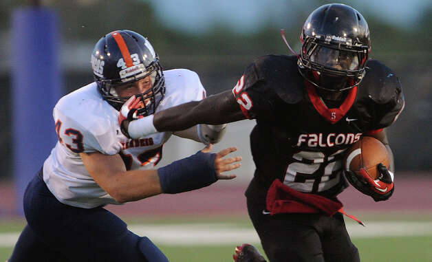 Marquie Hinton (22) of Stevens eludes Cameron Rogers of Brandeis during high-school football action at Gustafson Stadium on Thursday, Sept. 27, 2012. Photo: Billy Calzada, Express-News / © San Antonio Express-News