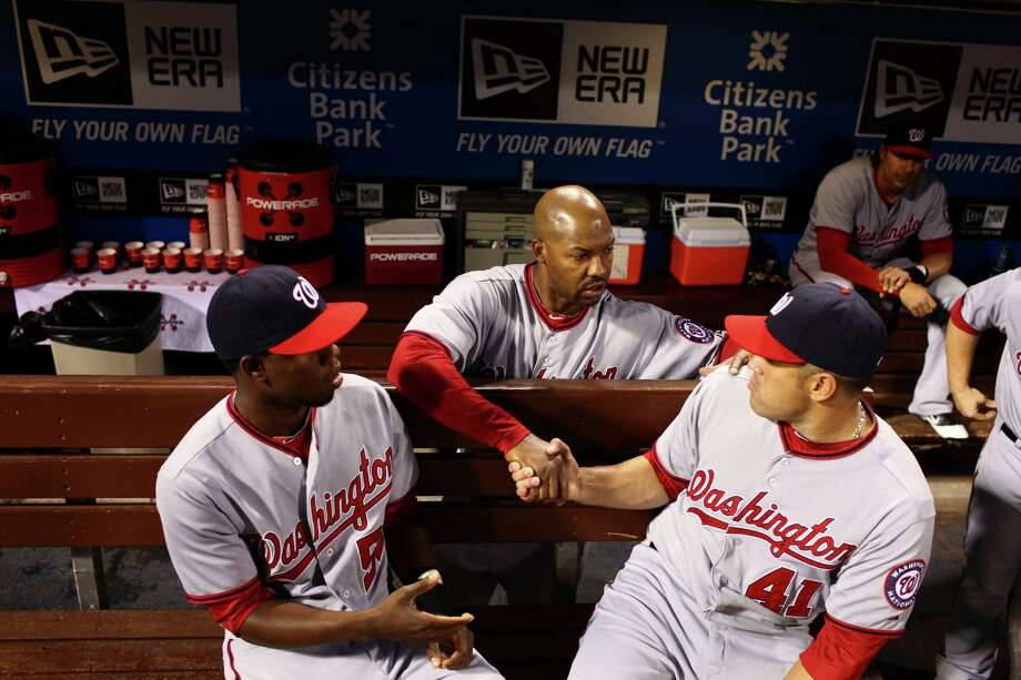 Washington Nationals' third base coach Bo Porter shakes hands with Sandy Leon, right, and Eury Perez before their game against the Philadelphia Phillies, Thursday, Sept. 27, 2012 in Philadelphia. Photo: Douglas Bovitt, For The Chronicle / © 2012 Houston Chronicle
