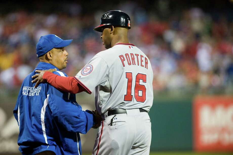 Washington Nationals' third base coach Bo Porter greets Philadelphia Phillies staffer Star Cruz during their game, Thursday, Sept. 27, 2012 in Philadelphia. Photo: Douglas Bovitt, For The Chronicle / © 2012 Houston Chronicle